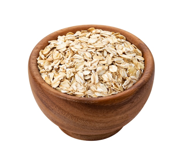 Oat flakes in wooden bowl isolated