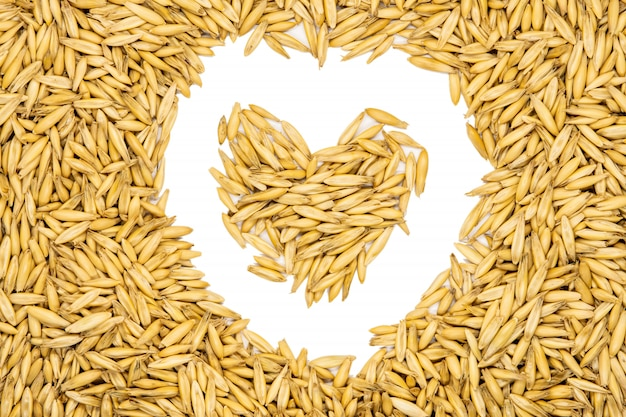 Oat seeds, heart-shaped, isolated, close up, macro, top view.