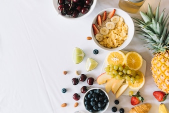 Oatmeal and healthy fruits on white background