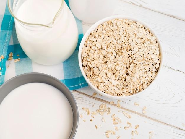 Oatmeal bowl and jar of milk
