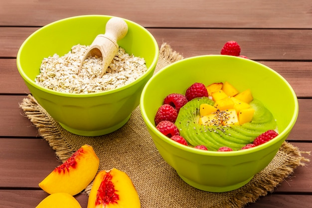 Oatmeal bowl with fresh berries and fruits