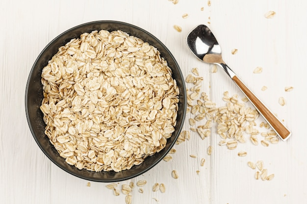 Oatmeal bowl with spoon on the table