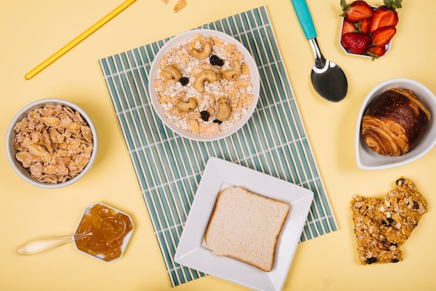 Oatmeal in bowl with toast and berries on table