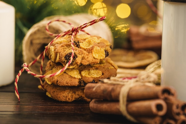 Oatmeal cookies on a old wooden  with cinnamon sticks and decorations