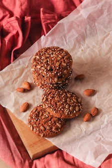 Oatmeal cookies with almonds on a beige background with copy space, top view.