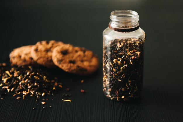Oatmeal cookies with chocolate chips. cookies with tea on a black surface selective focus