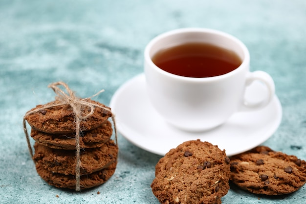 Oatmeal cookies with a cup of tea.