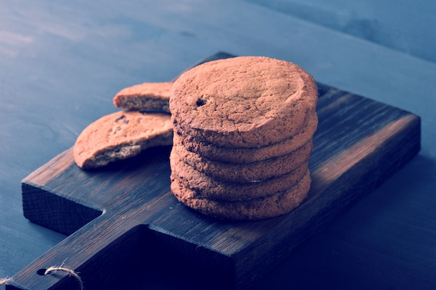 Oatmeal cookies on a wooden rustic board