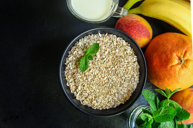 Oatmeal in a cup and fruits