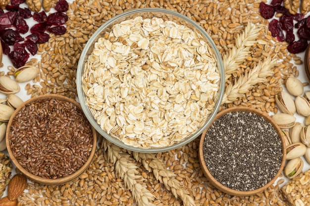 Oatmeal, flax seeds, quinoa. wheat grains and spikelets of wheat, nuts, raisins.