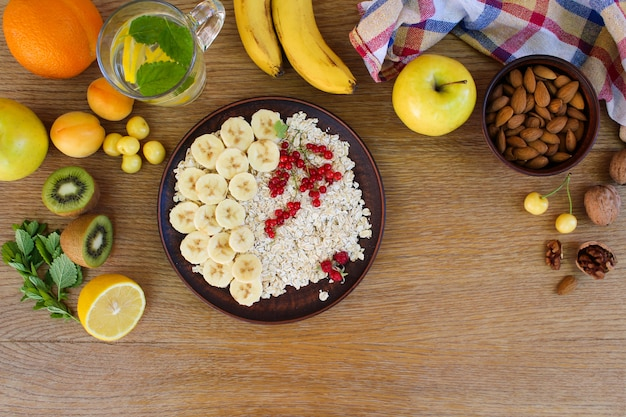 Oatmeal and fruit on the table