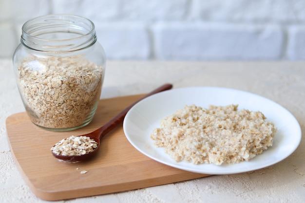 Oatmeal and glass jar with oatmeal, vegan breakfast