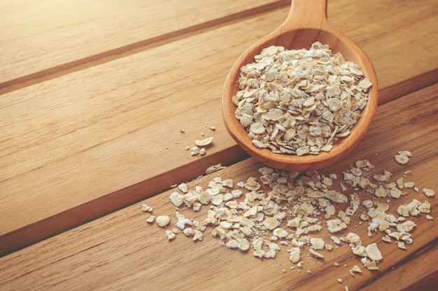 Oatmeal is placed on a brown wood .