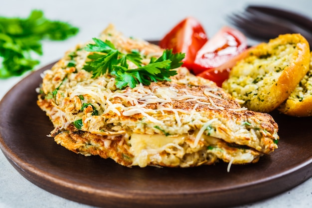 Oatmeal omelette with cheese and herbs,