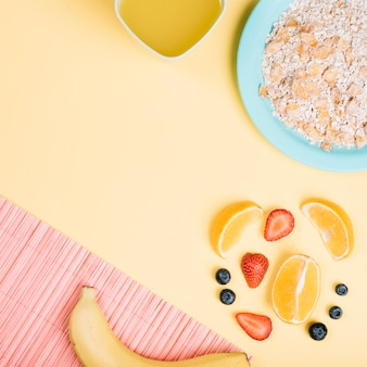 Oatmeal on plate with fruits on table