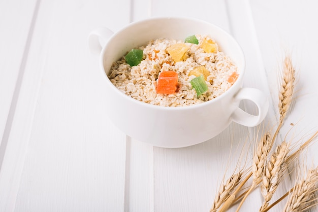 Oatmeal porridge in bowl topped with fresh jelly candies