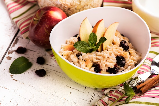 Oatmeal porridge with berries and fruits