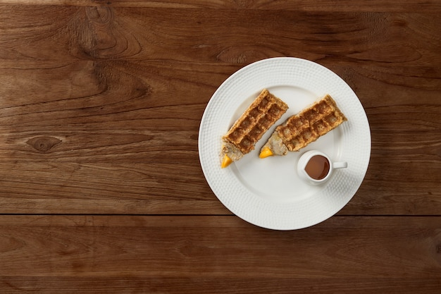 Oatmeal waffles in pencil shape on rustic wooden table
