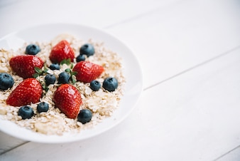 Oatmeal with different berries in bowl