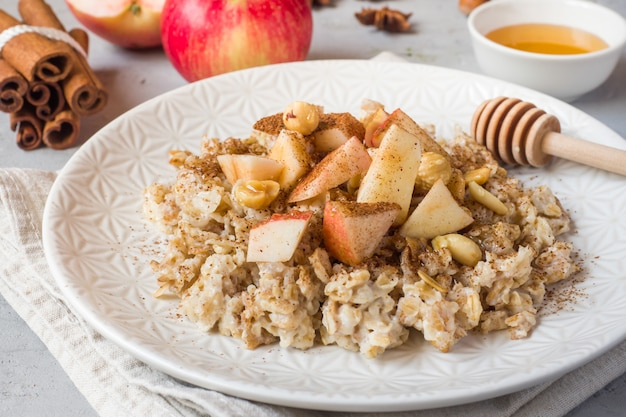 Oatmeal with fresh apples, nuts and cinnamon
