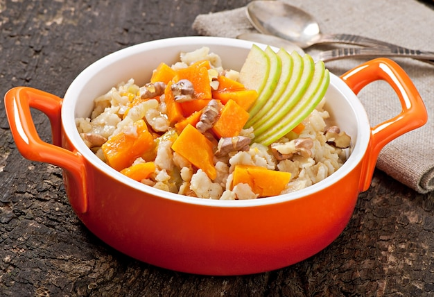 Oatmeal with pumpkin, apples, nuts and honey