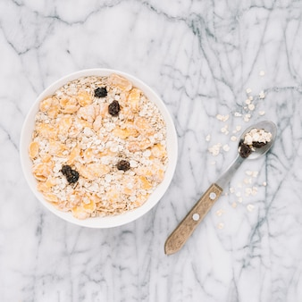 Oatmeal with raisins in big bowl