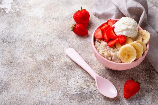 Oatmeal with strawberry, banana and ice cream