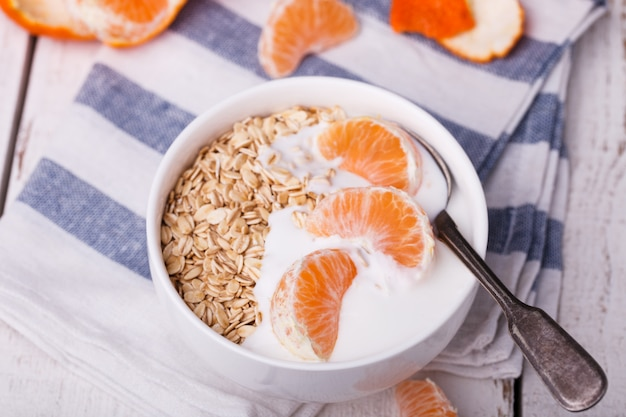 Oatmeal with yogurt and mandarin.healthy breakfast