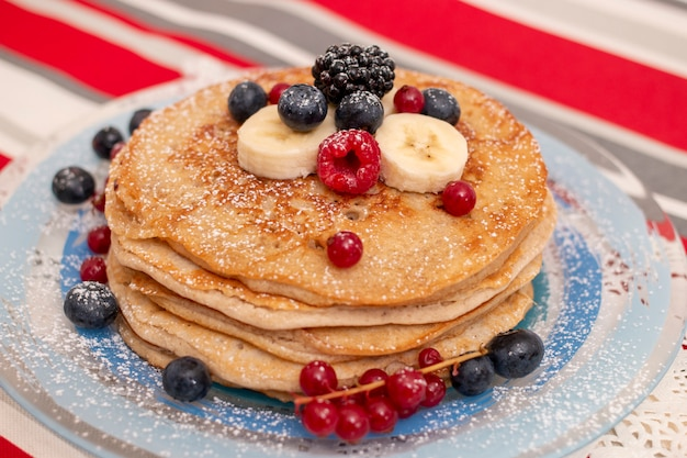 Oats and banana pancakes with berries