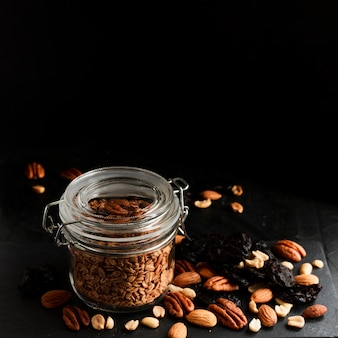 Oats jar with nuts mix and dates