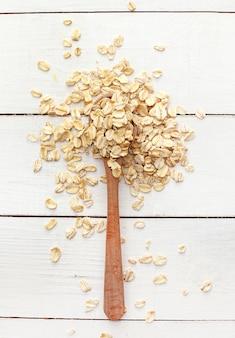 Oats on wooden spoon