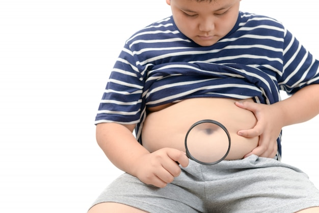 Obese boy overweight  holding magnifying glass