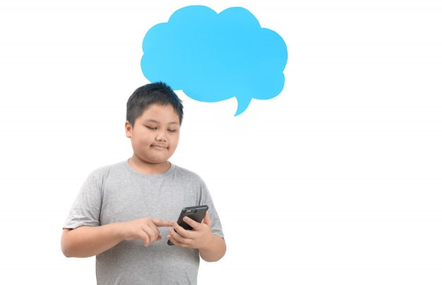 Obese boy play smartphone with empty blue speech bubble isolated