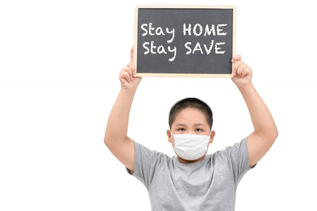 Obese fat boy wear mask shows blackboard with stay home stay save words