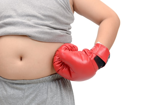 Obese fat boy wearing red boxing gloves isolatedt
