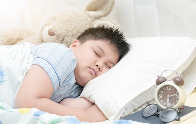 Obese fay boy sleep on bed