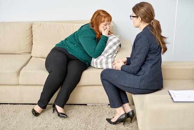 Obese woman having psychiatrist consultation