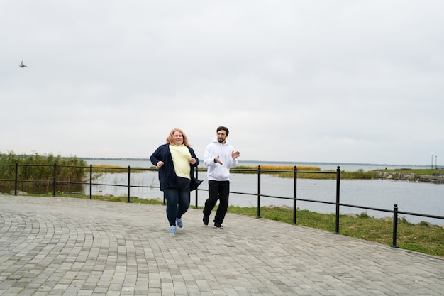 Obese woman running outdoors