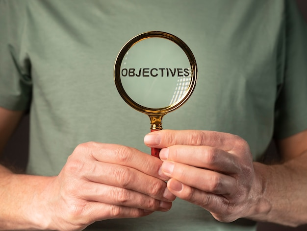 Objective word through magnifying lens zoom glass