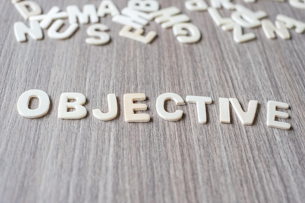 Objective word of wooden alphabet letters. business and idea concept