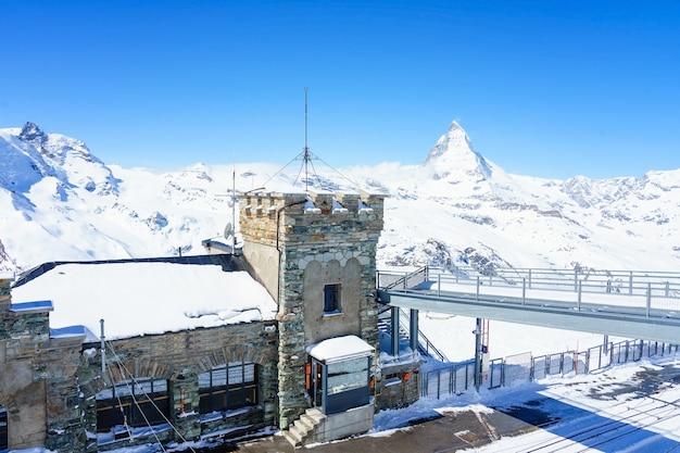 The observatory on gornergrat summit overlooking matterhorn as background in zermatt