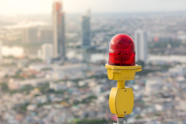 Obstruction light with city background