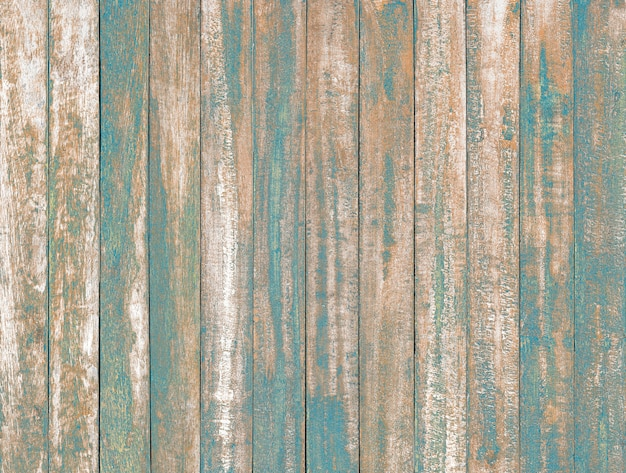 Ocean blue color peeling paint on vintage wood table background texture .