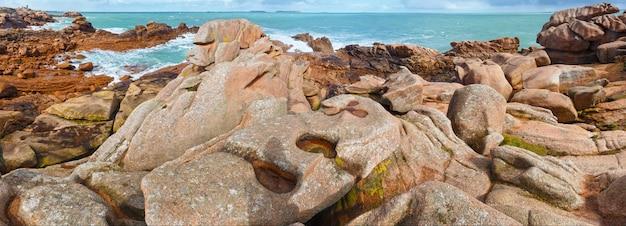 Ocean coast spring view (between perros-guirec and pleumeur-bodou, brittany, france). the pink granite coast.