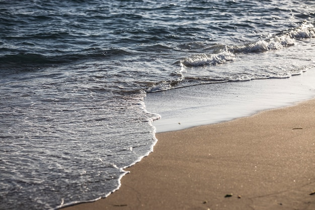 Ocean waves hitting the beach