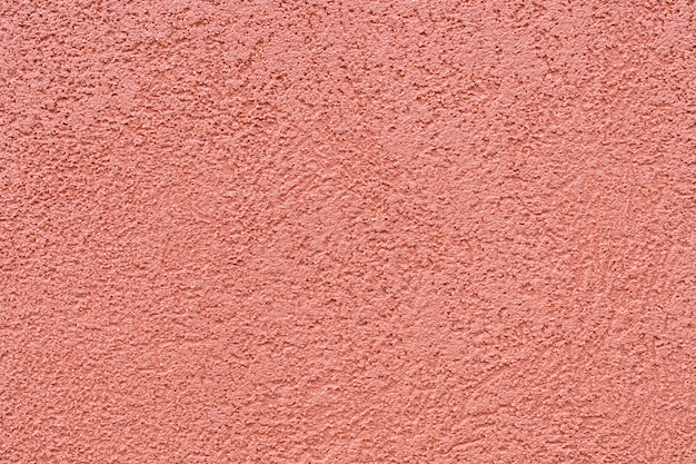 Ocher color texture of the plaster on the exterior walls.