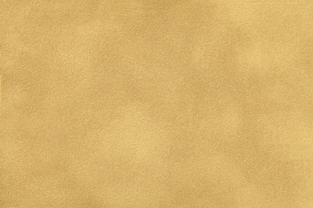 Ocher matt suede fabric closeup
