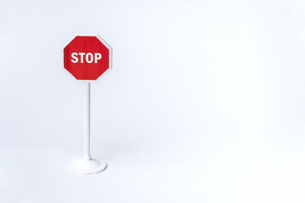 Octagonal red stop sign on white background