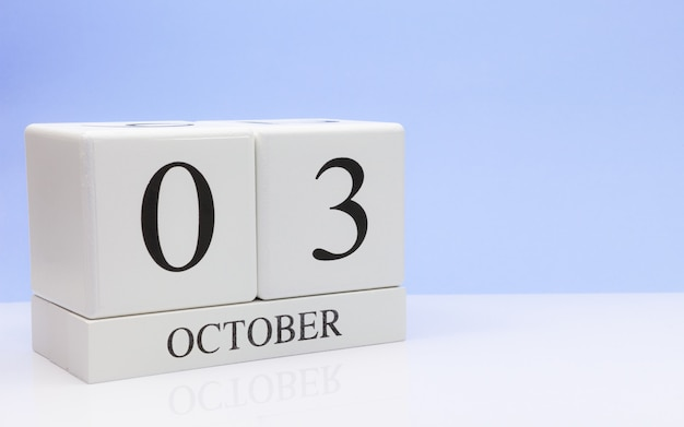 October 03st. day 3 of month, daily calendar on white table