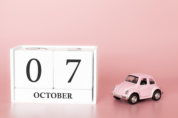 October 07th. day 7 of month. calendar cube with car